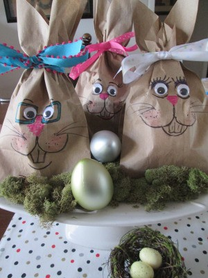 Making Bunny Bag Favors - bags clustered as a display with plastic eggs and moss