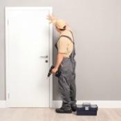 Handyman installing a door.