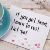 'If you get tired learn to rest not quit' written on a note near a teacup.
