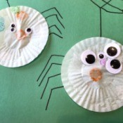 Making a Cupcake Liner Spider - finished spiders with legs and web drawn on for finishing touches