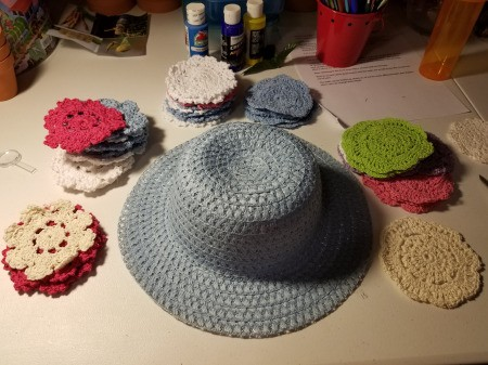 Spring Hat and Butterfly Door Hanging - cut ribbon from hat and gather doilies and other supplies