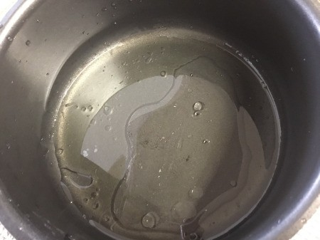 water & oil in pan