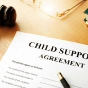 Legal paperwork for child support in the judge's chambers.