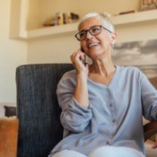 An older woman talking on the phone.