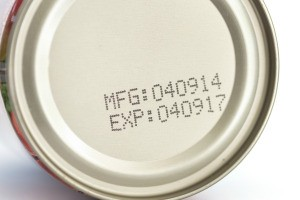 An expiration date on a can of food.