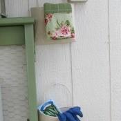Bucket Garden Storage - 2 pails hanging on the side of a garden storage building