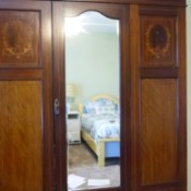 Determining the Value and Style of a Vintage Armoire - armoire with mirrored center door and two drawers