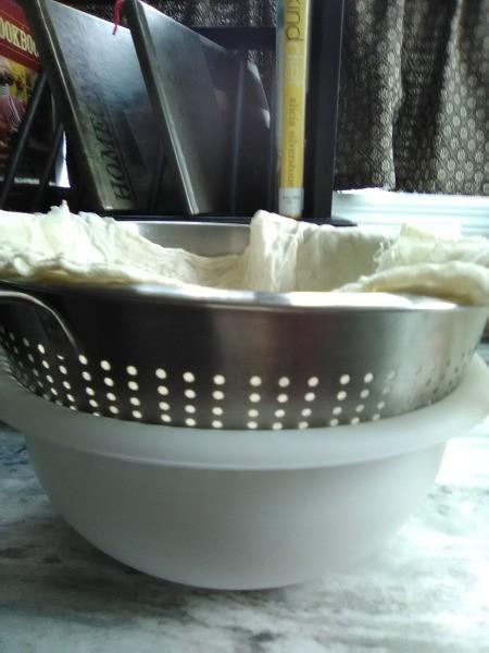 straining water thru cooked rice
