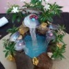 Pearl Water Falls Centerpiece - add artificial plants and flowers