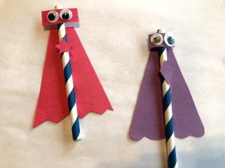 Making Super Hero Straws - glue capes to straws and then the other pieces as shown in photo