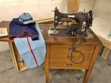 Advice for Choosing a Vintage Sewing Machine - vintage Domestic sewing machine in a cabinet