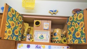 Above the Stove Sunflower Collection - finished decorated over the stove cabinet - full view with crochet sunflower and seed packet in the center