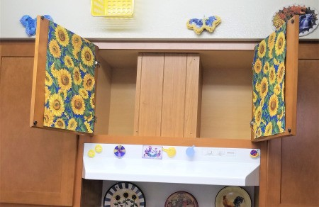 Above the Stove Sunflower Collection - empty cabinet with fabric drapes