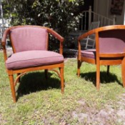 Value of African Teak Chairs - two light wood upholstered chairs