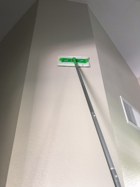 Using a Swiffer to Clean Walls - wiping down walls with a Swiffer dry floor duster