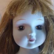 A porcelain doll's face.