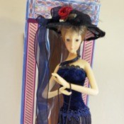 Identifying a Cathay Collection Porcelain Doll - tall slender doll in fancy dress and hat