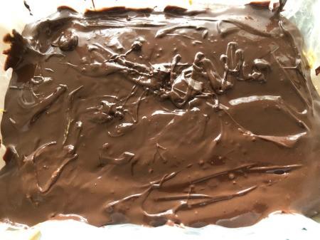 adding Chocolate to top of pan