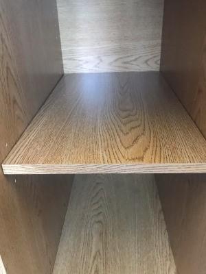 The shelf inside a repaired desk.