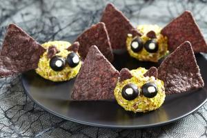 Bat cheese balls on a plate.