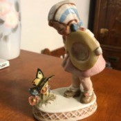 Identifying a Vintage Figurine from Germany - girl with butterfly on flowers