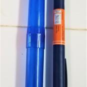 A toothbrush holder next to an insulin pen.