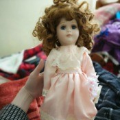 Identifying Porcelain Dolls - pink and white lace dress