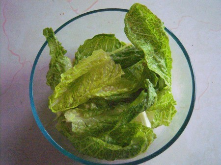 A bowl of freshly washed lettuce.