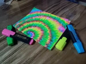 Tie Dye Notebook Cover - finished notebook surrounded with the markers used