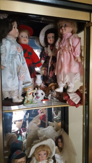 Value of The Four Seasons Collection Dolls - dolls in a display case