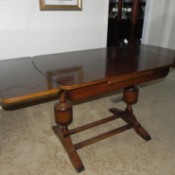 Value of a Vintage or Antique Table -  dining table with ends that pull out and up to expand the surface area
