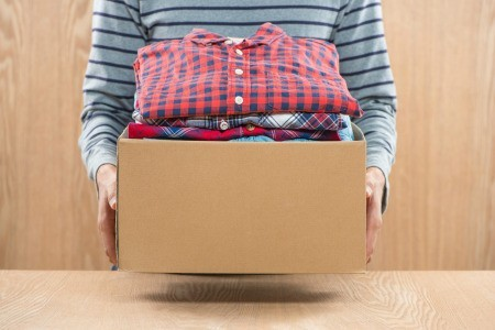 A box of clothing to be sold or given away.