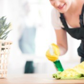 A woman cleaning a countertop.