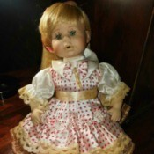 Identifying a Porcelain Doll - doll wearing a polka dot dress with lace edging and pantaloons