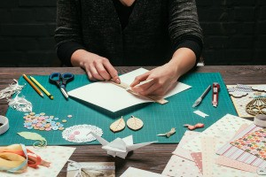 A woman making homemade greeting cards.