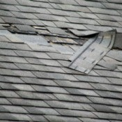 A house with some roof damage.