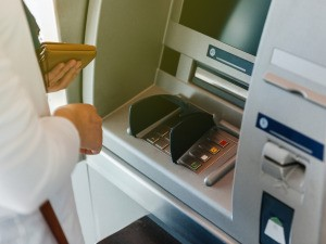 A person using an ATM at a bank.