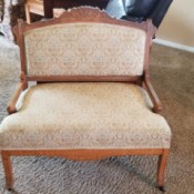 Identifying Antique Furniture - wide upholstered chair with wood trim and arms