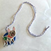 How to Make a Bottle Cap Necklace for Toddlers - finished necklace with a dog on the front