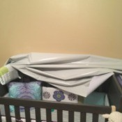 Reattaching Peel & Stick Wallpaper - pile of wall paper slumped on a crib