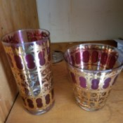 Value of Vintage Drinking Glasses - two different size glasses decorated with a gold filagree and purple pattern