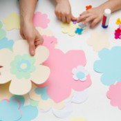 Hands making paper flowers