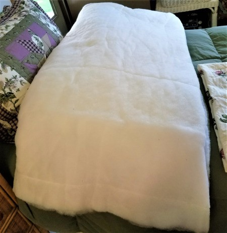 A king sized comforter that has been deconstructed and saved for reuse.