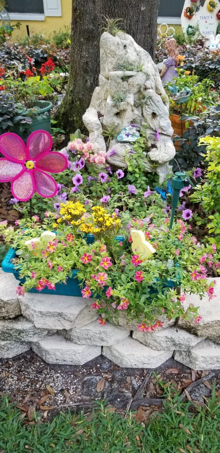 A garden bed with a waterfall of flowers.