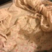 Restoring a Worn Out Blanket - very worn white blanket with small pink flowers