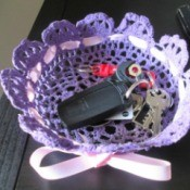 How to Make a Stiffened Doily Bowl - car keys in purple bowl which has had a pink ribbon laced through it