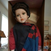 """Information on a J Misa Porcelain Doll - doll in the box wearing """"plain"""" clothes in solid colors"""