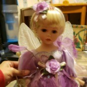 Value of a Heritage Signature Collection Porcelain Doll - doll in fairy attire