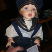 Value of a Collectible Memories - boy doll in perhaps a sailor suit