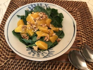 Baby Kale Walnut Orange Salad on plate